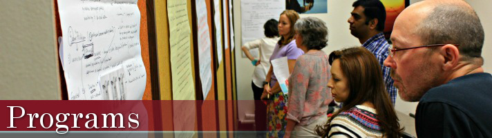 Programs Banner: People looking at bulletin board