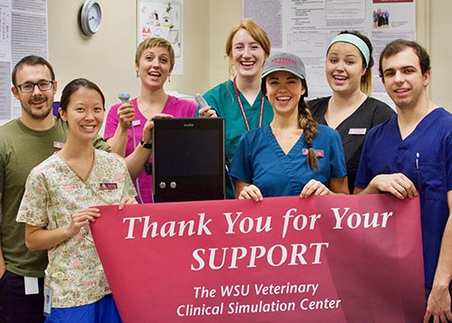 Veterinary students say Thank You! for ultrasound machine purchased by donor