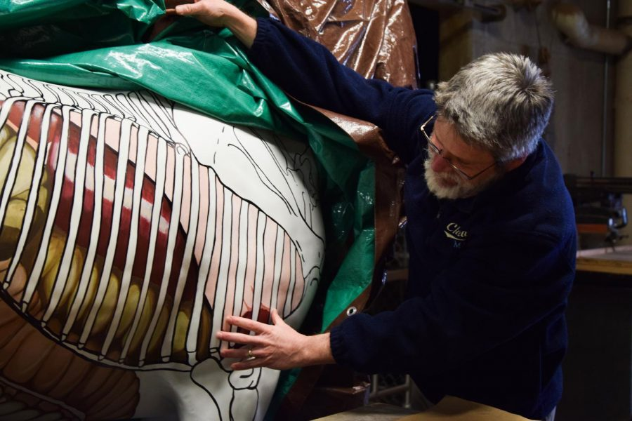 Patrick D. Wilson, clinical assistant professor in the Department of Integrative Physiology and Neuroscience, discusses the merits of using the painted life-size horse sculpture in a classroom setting Tuesday in McCoy Hall.